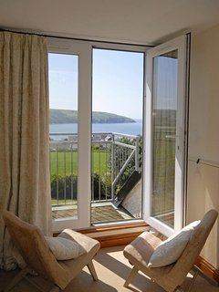 Gwbert holiday home - master bedroom with views to Poppit sands
