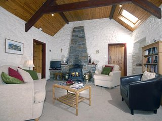 Cottage in Pembrokeshire with log burning stove.
