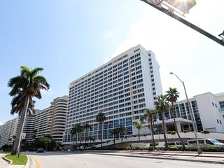 Waterfront condo w/ resort amenities like a shared pool, & partial ocean views