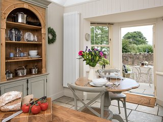 Cottage kitchen out to east facing rear dining terrace and private courtyard