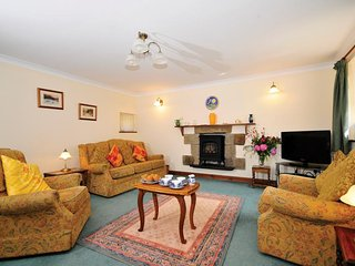 Sitting room large open plan room with electric cast iron stove