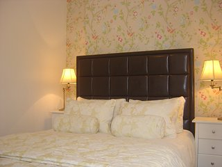 Luxury king size bed with ultimate Hungarian goose down duvet and pillows, in Laura Ashley style