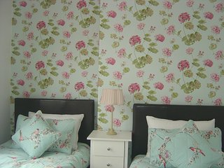 Twin beds with ultimate Hungarian goose down duvet and pillows, in Laura Ashley style