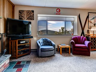 The living room w/ mountain views from the window