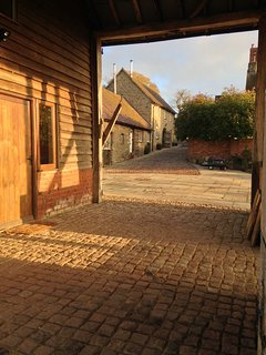 The cobble path from the terrace through the barn to the cottage