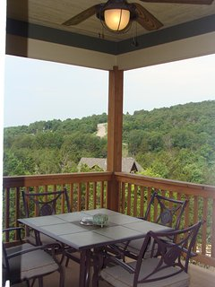 Grill and dining table on upper deck overlooking the beautiful Ozark mountains.