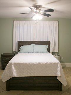 Bdrm #1 w/ ceiling fan, dresser and ensuite full bath.