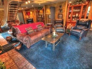 Main Level Living Area  - The main level living area has leather furniture.