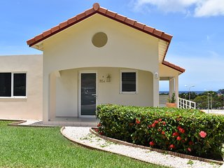 Luxury colorful caribbean townhouse. Royal Palm Resort. In upscale Piscadera Bay.