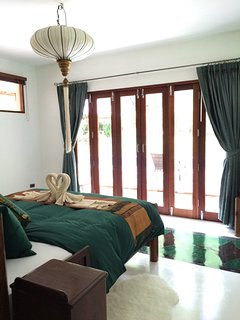 the master bedroom opens up to the balcony on the pool