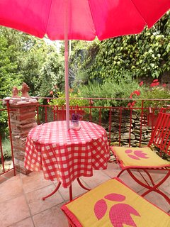 Cozy terrace just outside the kitchen. Enjoy cool mountain breeze!