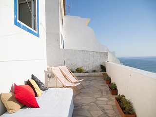 Seafront house with a terrace in historical centre, Ericeira