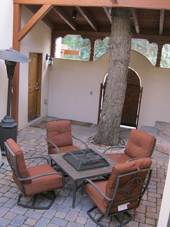 LITED COVERED ENTRANCE /COURTYARD AND FIRE PIT