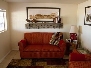 Enjoy our cozy living room.  The loveseat makes into a comfortable bed for one adult or 2 small kids