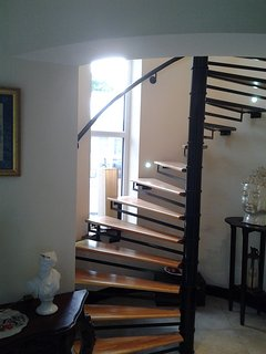 Spiral staircase from entrance lobby to first floor Sitting Room and bedrooms.
