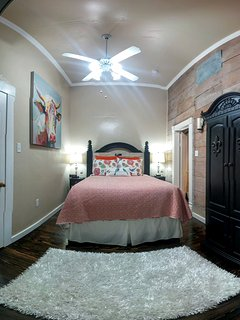 Guest Bedroom with Queen Pillow Top Mattress.  12' Ceilings.  Original 1800's wood plank wall.
