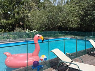 pool safety fence, toys, deck chairs