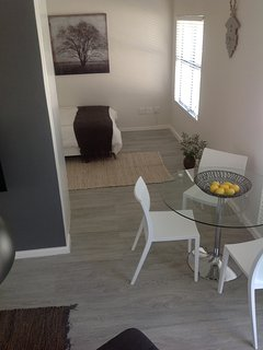 open plan dining and bedroom around the corner