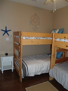 This room has two bunk beds (4 twins) and a roll-away bed in the closet.