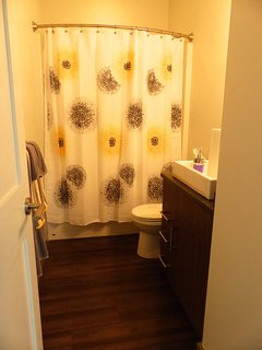 2nd full bathroom downstairs with bath and shower.