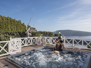 Relax body and mind to our outdoor heated hydro-massage spa.