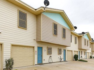 4 bedroom 3 bath home, Community Pool, Half a block to the beach!!