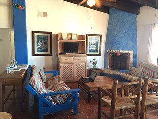 Living Room has flat screen TV, Satellite, WIFI and a fireplace.