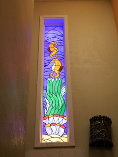Ocean themed stained glass window in stairwell