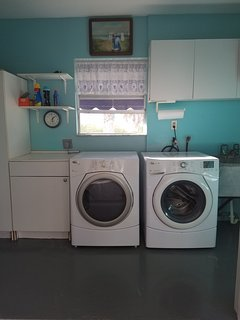 Laundry room with sink and closets