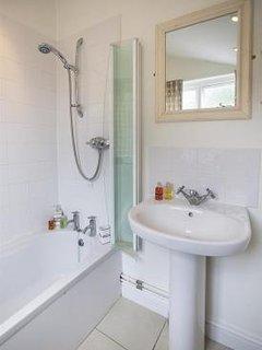 Bathroom with bath and shower