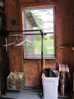Front entry with coat rack and yard games