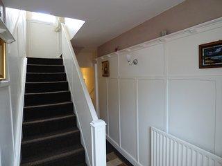 Wood panelled passage.