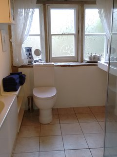 Spacious bathroom with original stone window sill