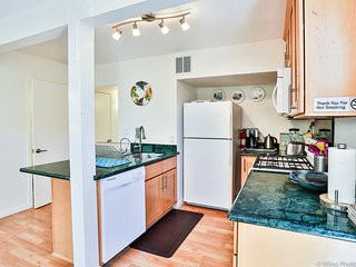 New cooks kitchen with granite counter tops, new appliances: dishwasher, gas range, microwave.