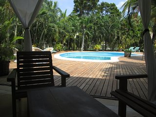 Terrace of two bedroom bungalow just steps to the pool