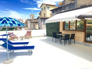 Large sunny terrace with remote control blind