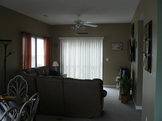 Living room with wall mounted flat screen TV, DVD player and stereo