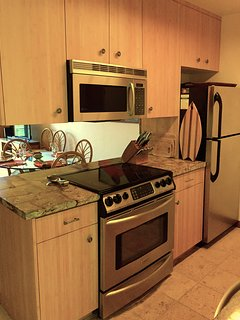 Bamboo cabinets, large stove and oven, full-sized refrigerator, microwave