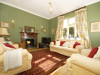 National Botanical Gardens - spacious holiday house family sitting room with open fire
