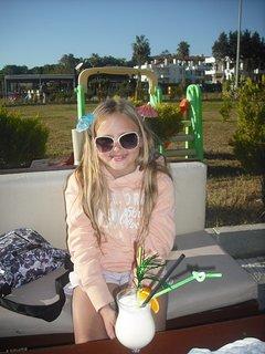 My daughter at a beach bar