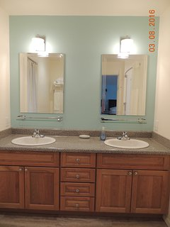 Large full bath with double vanities