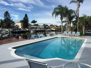 Newly renovated house w/ pvt dock and heated pool, walking distance to beach!