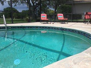 Large kidney shaped heated pool.