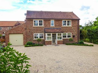 SLEEPY WILLOWS, detached brick-built house with gas stove and enclosed garden, i