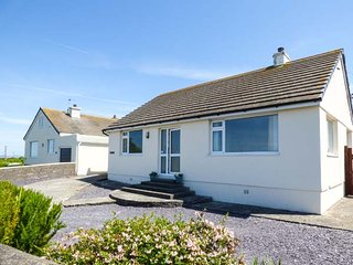 BRYN HAUL detached bungalow, pet-friendly, enclosed garden, close to beach, in