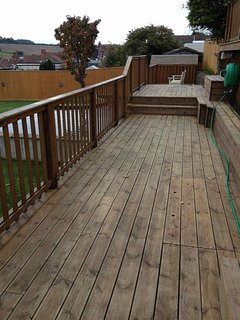 Lower Decking - Hot Tub to the right (on upper decking) and Koi Pond to the left