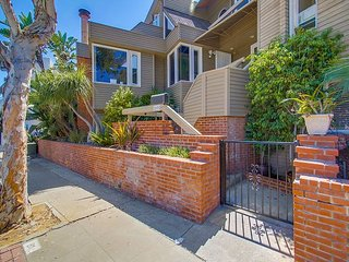 Spacious South Mission 4-bed/3-ba townhouse w/ 3-car parking on ocean side.