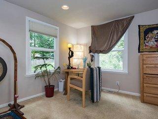 Guest Room showing 2 of 3 windows, desk, chair & dresser