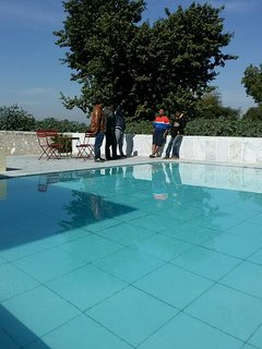 guest enjoying at pool side
