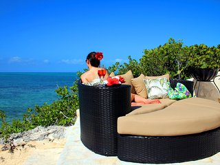 Secluded sunbathing deck with circular zen bed overlooking the Caribbean sea.